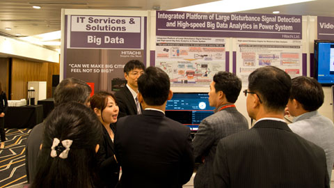 Explaining Hitachi's Big Data solutions to interested visitors.