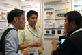 Central Research Laboratory exhibitors were explaining Hitachi's technology to a visitor